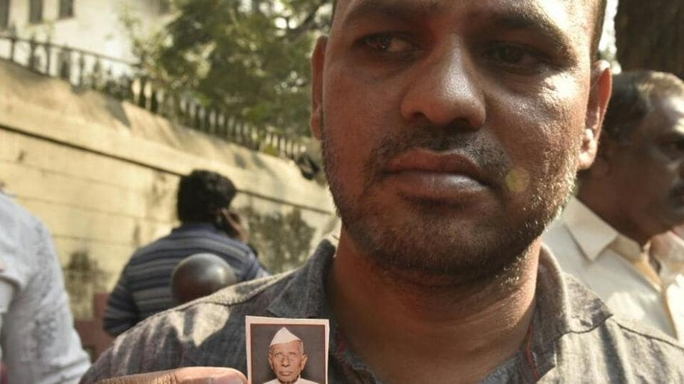 Dharma Patil's son shows his picture.