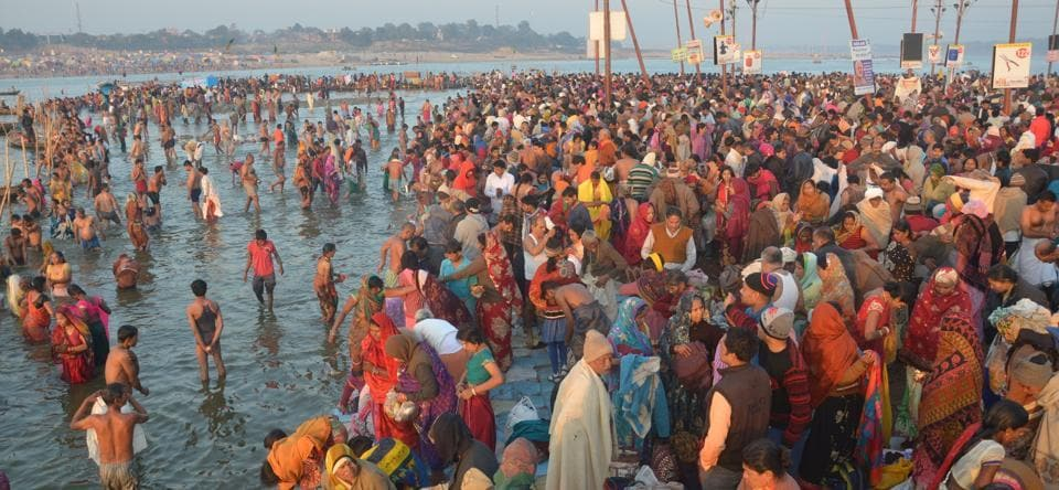 Saints and devotees take dip in Sangma and perform rituals during maghi Purnima bathing on Wednesday.
