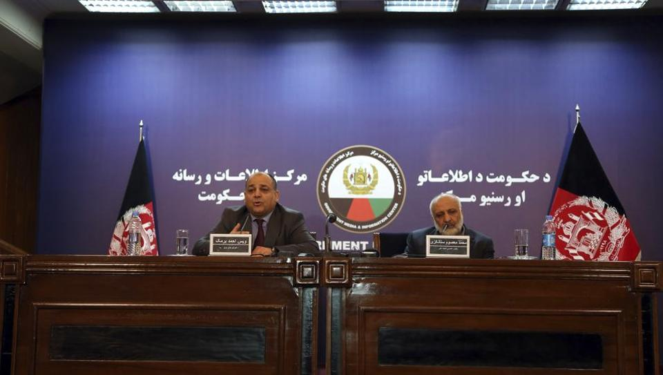 Wais Ahmad Barmak, interior minister, left, and Masoom Stanekzai Afghanistan's intelligence chief, right, speaks during a joint press conference in Kabul, Afghanistan, Thursday, Feb. 1, 2018.