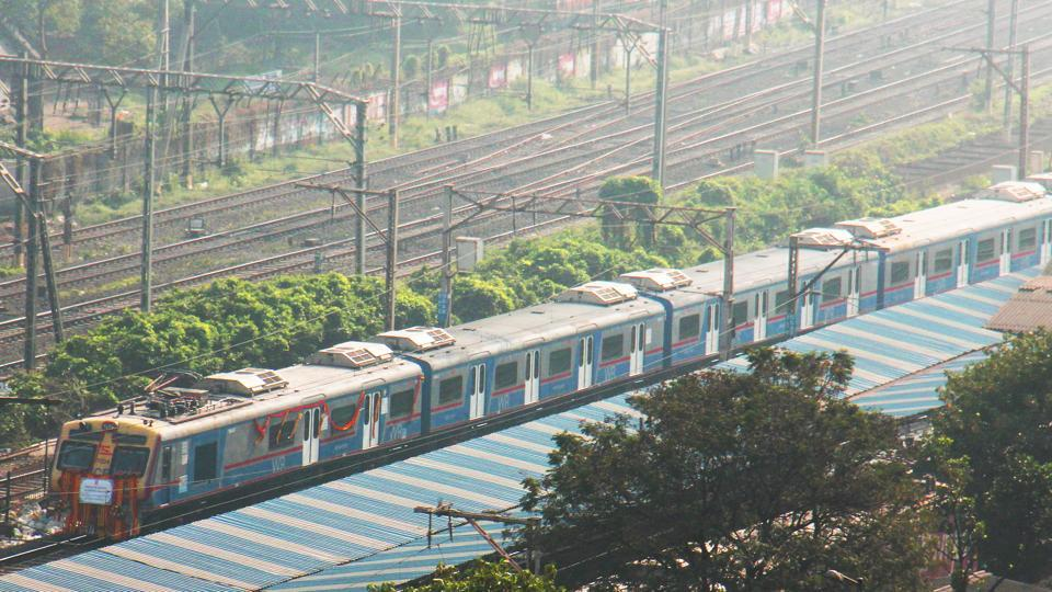 Commuters travel in first air-conditioned local train from Borivali to Churchgate in Mumbai, India, on December 25, 2017.
