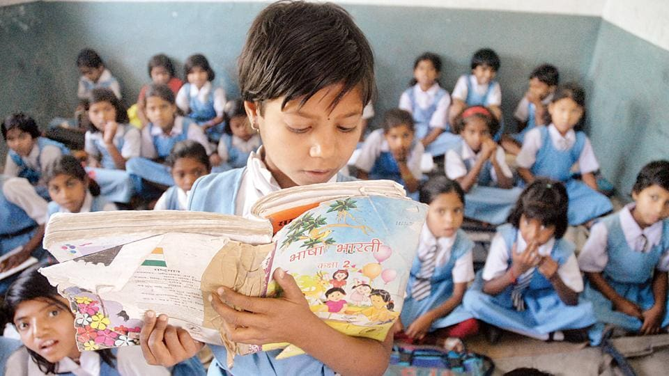 A student reading a lesson at a government school in Bhopal.
