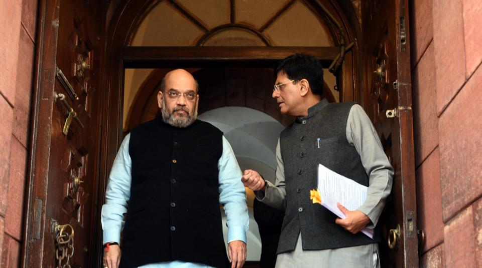 Minister of Railways of India, Piyush Goyal interacts with BJP National President Amit Shah during the first day of 2018 Parliament budget Session, in New Delhi.