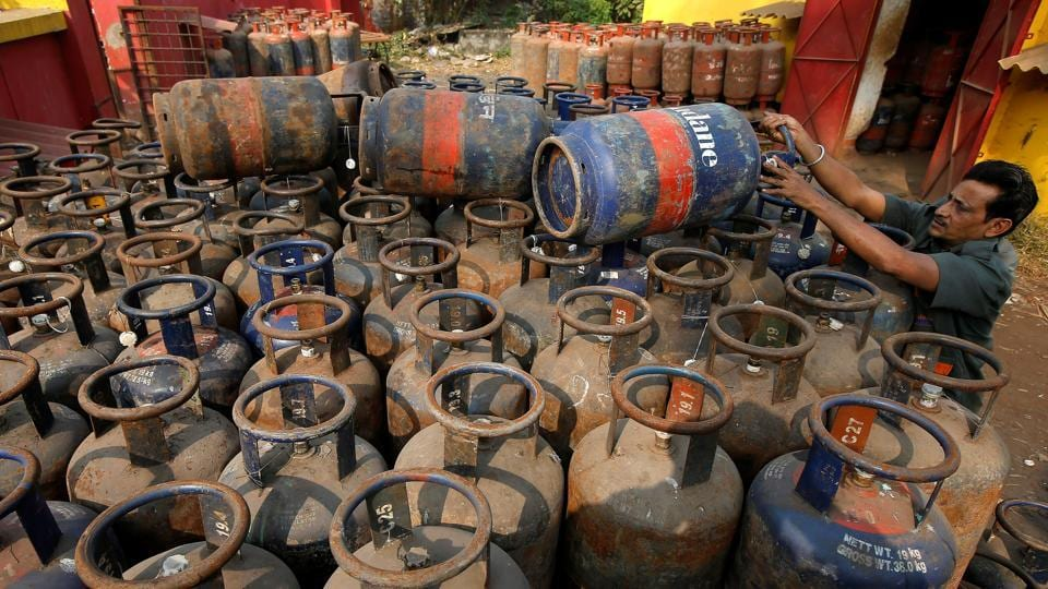A worker arranges cooking gas cylinders at a depot in Kolkata. The Pradhan Mantri Ujwala Yojana will give 8 crore women new LPG connections Jaitley said. (Rupak De Chowdhuri / REUTERS)