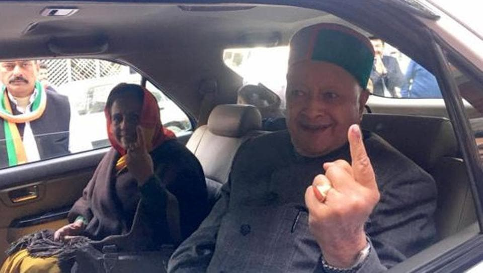 Virbhadra Singh with his wife Pratibha after casting his vote in Shimla during the Himachal Pradesh state election, on November 9 2017.