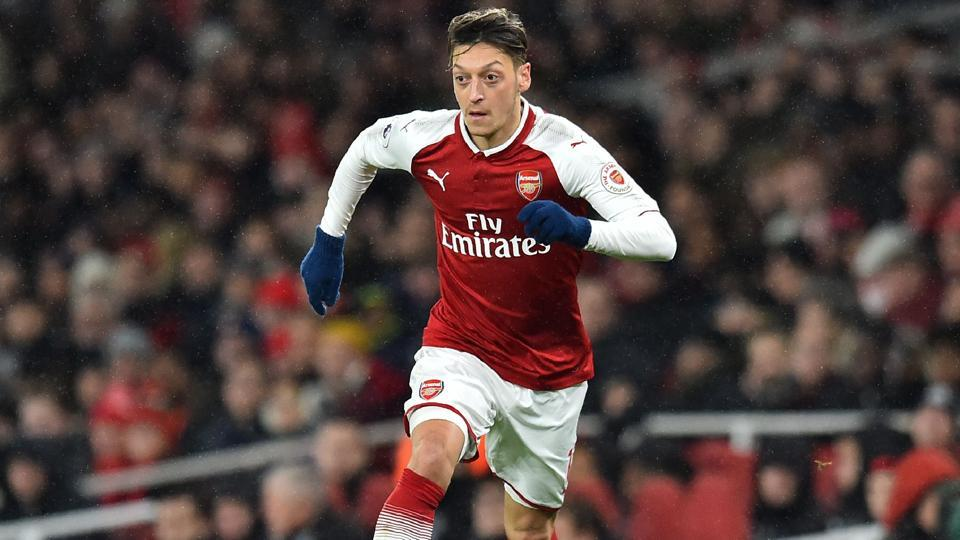 Mesut Ozil has signed a three-and-a-half-year contract extension with Arsenal to end the saga over his future at the club.
