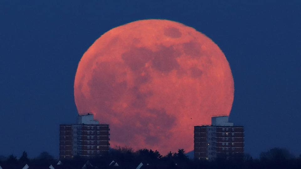 A full moon rises behind blocks of flats in north London, Britain. The next blue moon total lunar eclipse will happen on December 31, 2028, though it won't be quite as large since it will not be as close to Earth. Another will occur on January 31, 2037. (Eddie Keogh / REUTERS)