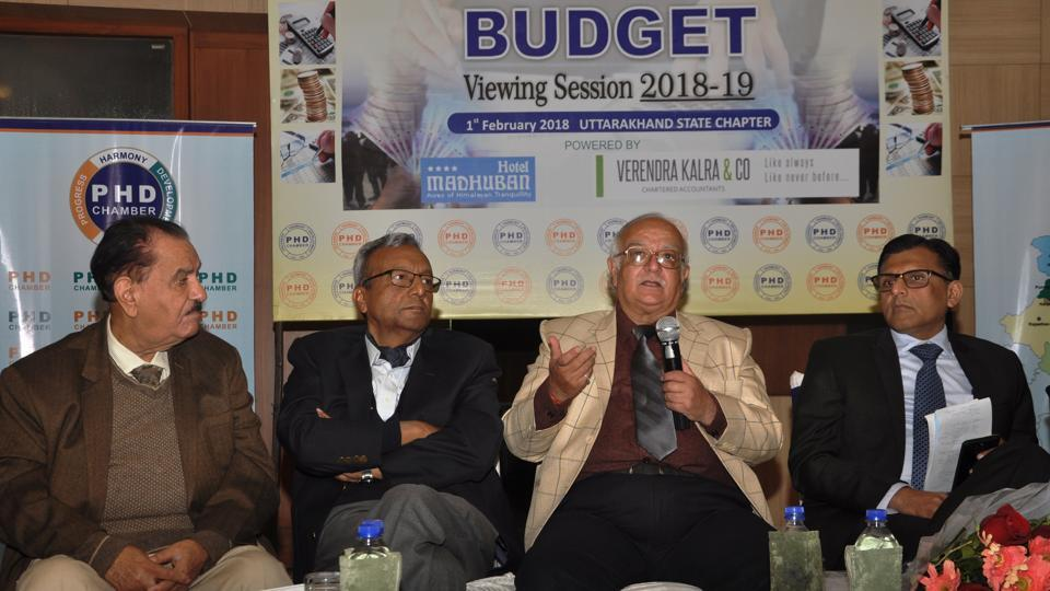 Former chief secretary IK Pande (second from right) speaks at a programme held on Budget in Dehradun.