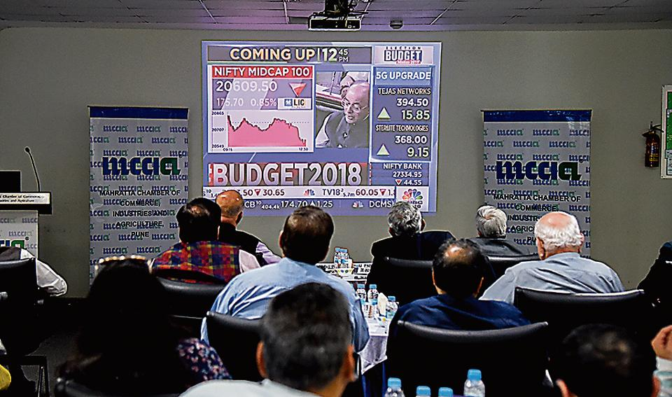Industrialists and experts watch the live telecast of presentation of Union Budget 2018-19 by Union finance minister Arun Jaitley at Navalmal Firodia Hall, MCCIA, on Thursday.