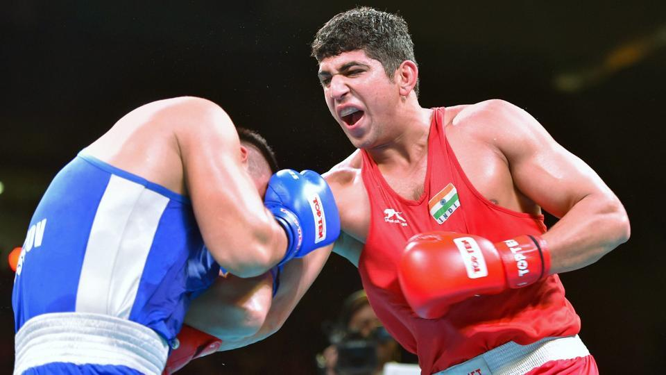 Sanjeet Kumar(right) in action against Tursunov Sanjar of Uzbekistan during the final of the 91 kg category at the India Open International Boxing Tournament in New Delhi on Thursday.