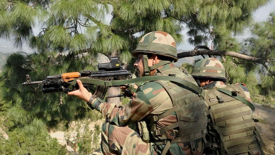 Indian army soldiers take positions near the Line of Control in Nowshera sector of Rajouri near Jammu.