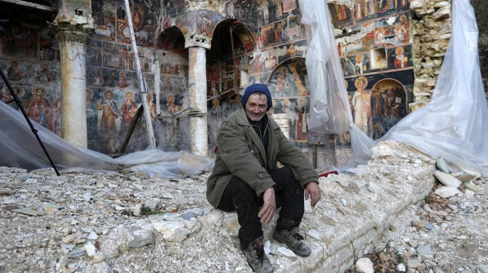 A man sits in the rubble at The Orthodox Church of Saint Athanasius in Leshnica, Albania. Many Orthodox churches in Albania dating from the Byzantine period or later in the south of the country, and the art they contain lie in ruins after decades of neglect but they could possibly become tourist magnets if only they are restored.  (Florion Goga / REUTERS)
