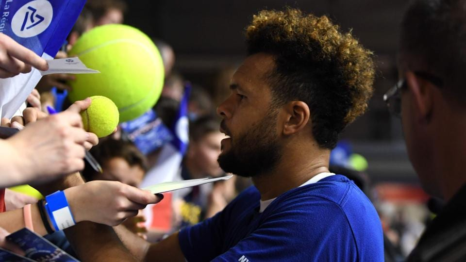France's Jo-Wilfried Tsonga signs autographs during a training session ahead of the Davis Cup tennis match between France and the Netherlands at the Halle Olympique Stadium in Albertville.
