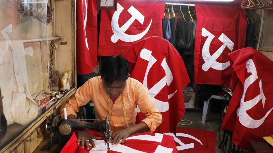A tailor stitches CPI(M) party flags at a workshop, ahead of Tripura assembly election, in Agartala on Friday.