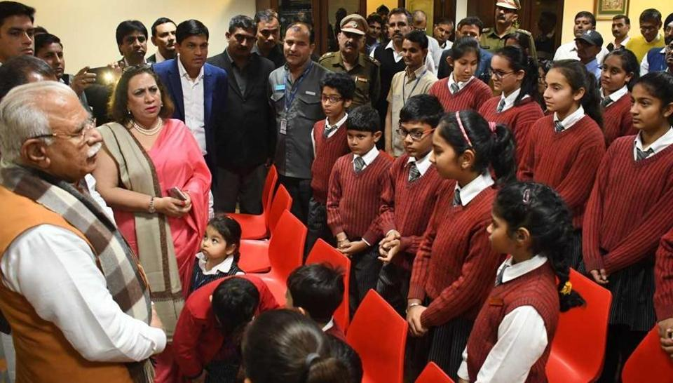 Haryana chief minister Manohar Lal Khattar interacting with students and staff.