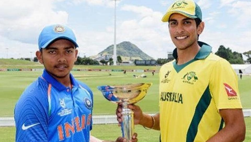 Captains Prithvi Shaw of India and Jason Sangha of Australia pose with the ICCU-19 Cricket World Cup trophy ahead of the final on Saturday.