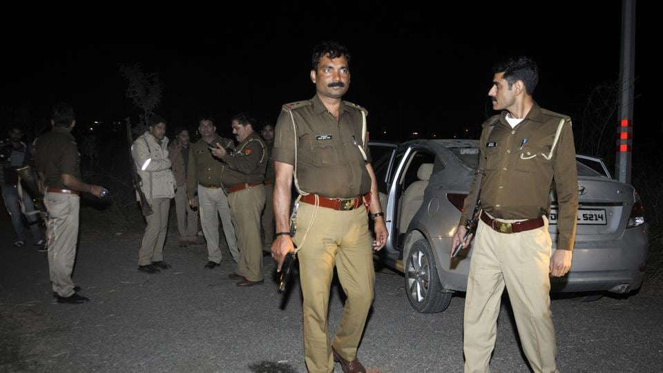 Noida Phase-3 police team at the encounter spot in Transport Nagar, Sector 69, on Friday evening.