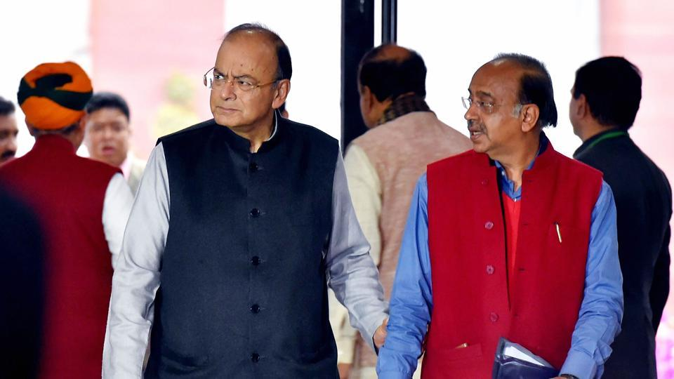 Unon finance minister Arun Jaitley and Union minister Vijay Goel arrive to attend the BJP parliamentary party meeting, during the Budget session of Parliament in New Delhi on Thursday.