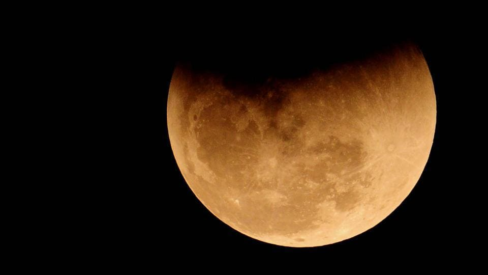 In Chandigarh, the moon put up a striking celestial show as a coppery red orb rose high up in the sky to mark a rare lunar eclipse on January 31, 2018. After decades, moon-gazers saw a super moon, when it looks bigger and brighter than ever, a blue moon, which is the second full moon in a calendar month, and a blood moon, a reference to the red colour of an eclipse.  (Ravi Kumar / HT Photo)
