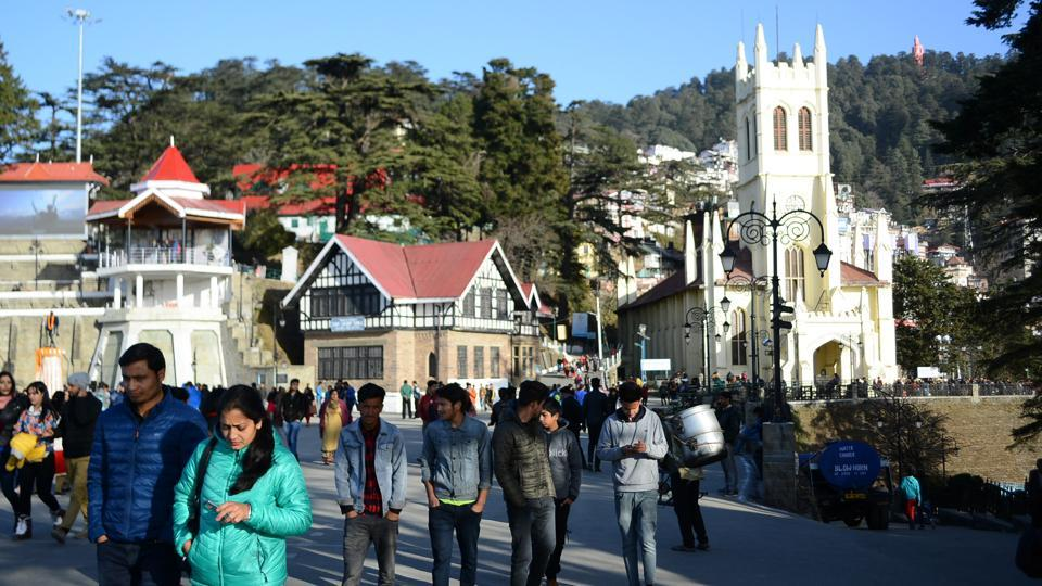 People stroll at the Ridge, which is a popular tourist spot. The ridge ground was constructed in 1910, when Shimla was the summer capital of British India.