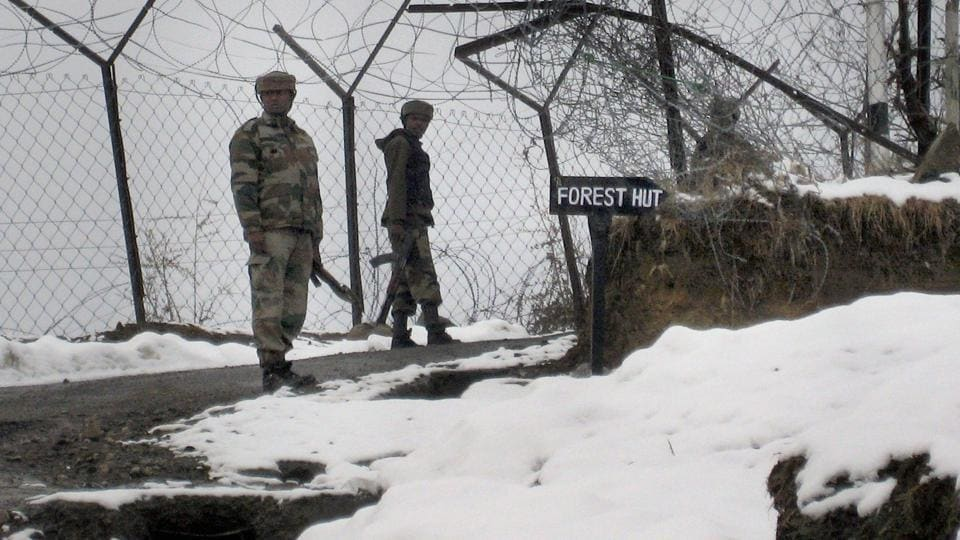 Army personnel patrol the snow-clad a road during heavy snowfall Peer Ki Gali in Poonch in Jammu and Kashmir. Security forces posted in the region have to face dangerous weather conditions every year.