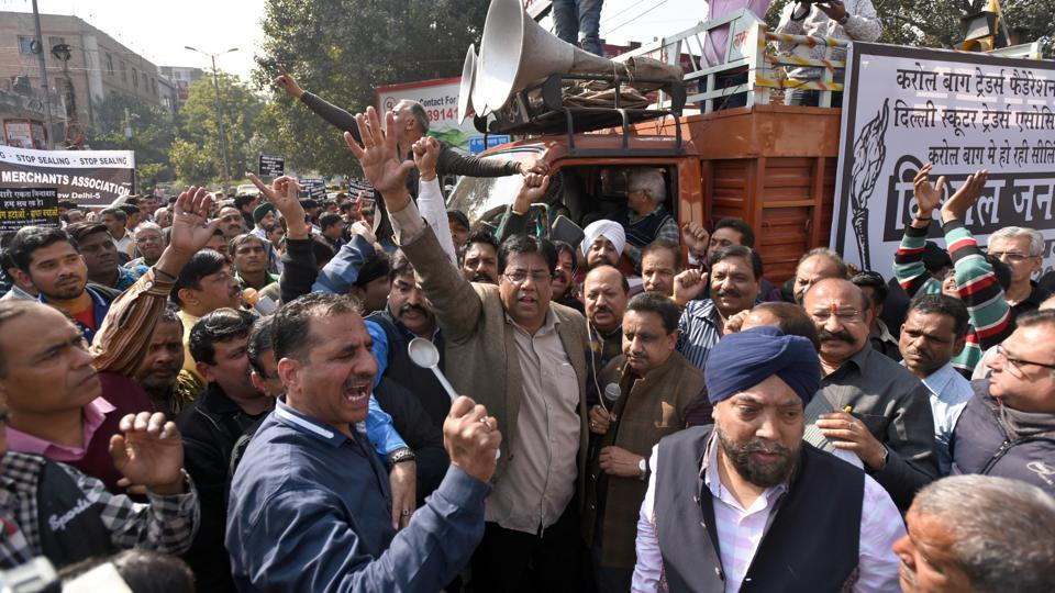 "Traders protest during the two days ""Delhi Bandh"" protest against the sealing drive by the Municipal Corporation of Delhi (MCD) at Karol Bagh on Friday. (Sushil Kumar / HT Photo)"