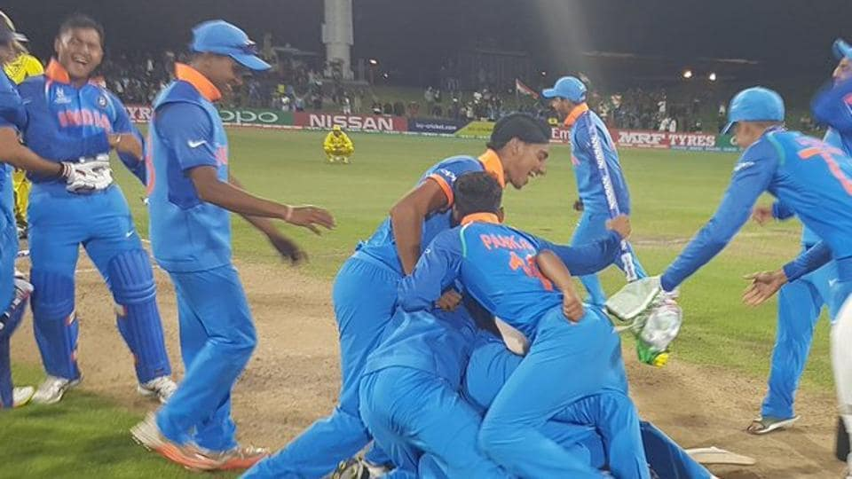 Indian players celebrate after beating Australia by eight wickets to win the ICC Under-19 Cricket World Cup for a record fourth time.