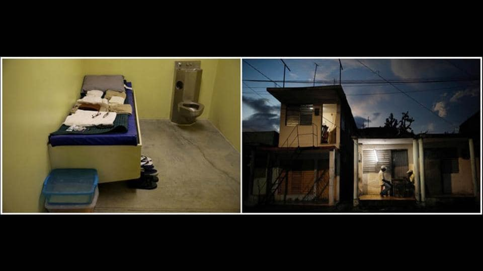 An austere, windowless cell for detainees at the base (L) contrasts with locals playing dominoes outside their homes at dusk. (Carlos Barria / REUTERS)