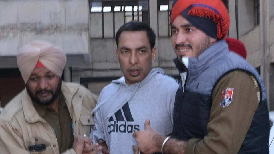 Gangster Ravi Deol outside the court wherein he was produced after four-day police remand on Saturday.
