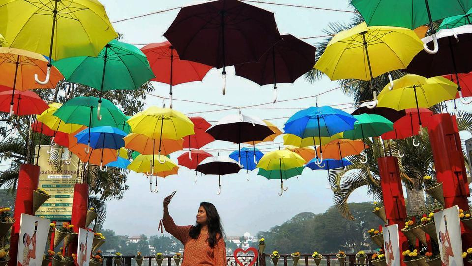 A young woman takes a selfie with umbrellas put up as a part of beautification drive for the upcoming Advantage Assam - Assam's Global Investors' Summit in Guwahati on Thursday.