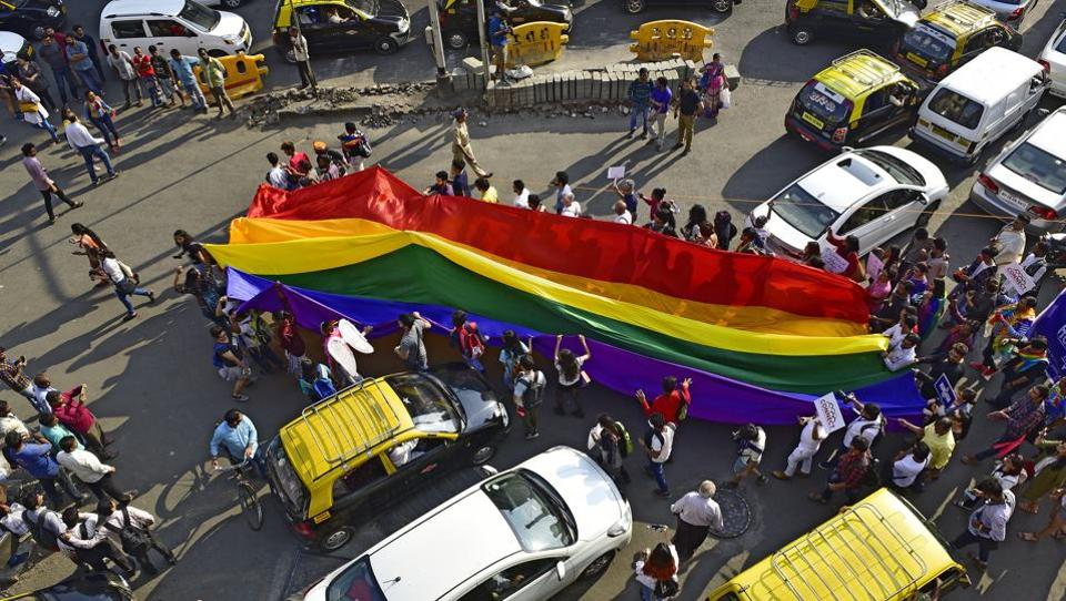 Participants walk as they carry a rainbow flag during the pride March in Mumbai. The LGBT community in Mumbai organised several events during the Pride Month, ranging from film screenings, plays, drag shows, rainbow kite flying and street performances. (Vijayanand Gupta / HT Photo)