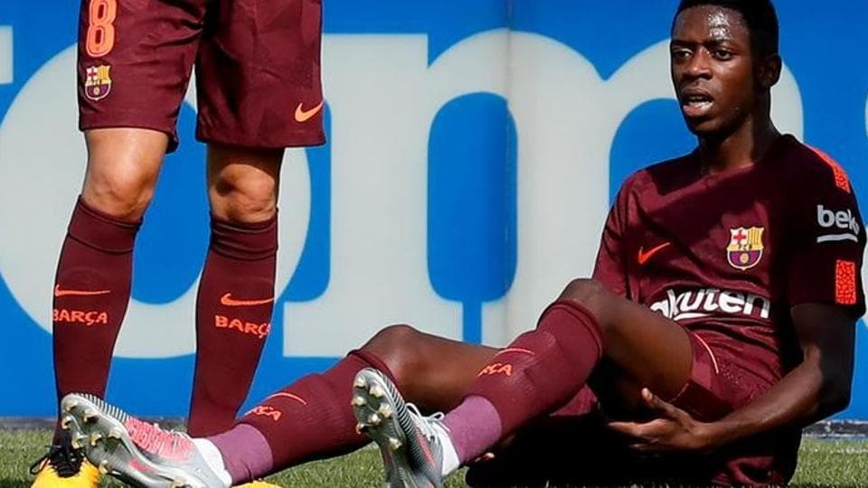 (File pic) FC Barcelona's record signing Ousmane Dembele reacts after sustaining an injury during his Spanish La Liga match against Getafe at Colisseum Alfonso Perez stadium in Getafe on September 16, 2017.