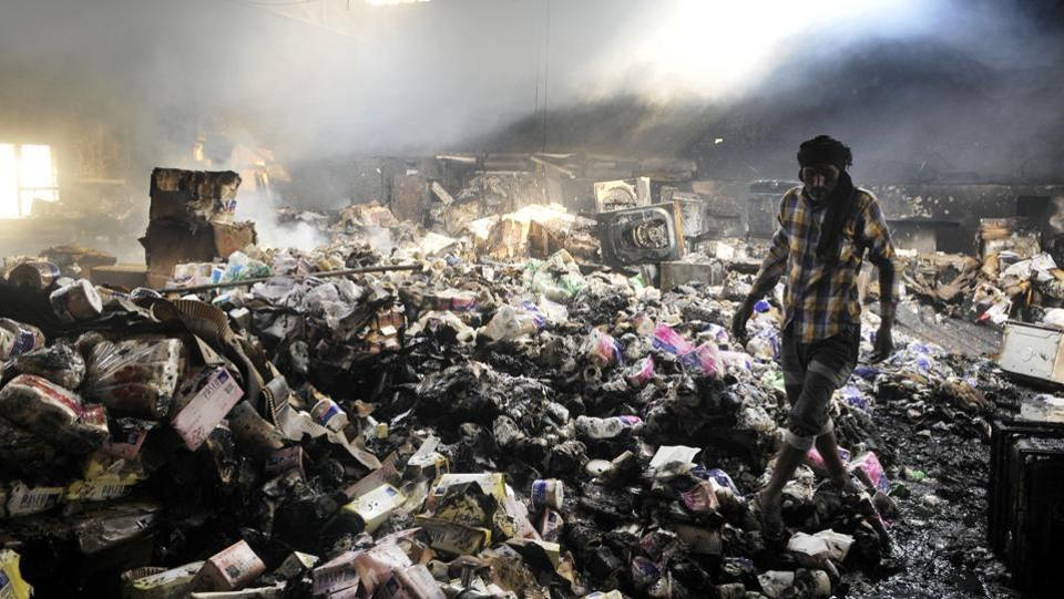 A worker amid the ravaged good at industrial area in Chandigarh on Friday.