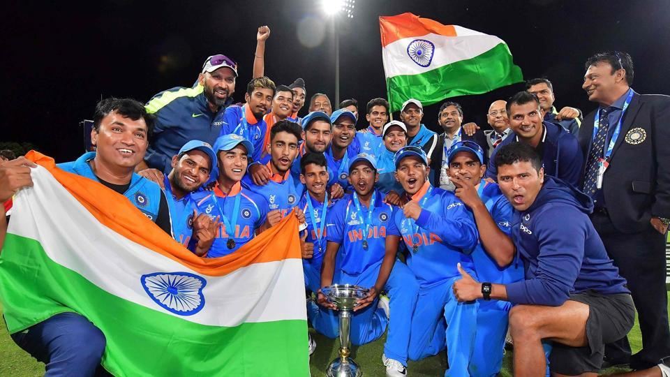 Indian U-19 cricket team players, led by Prithvi Shaw, celebrate with the trophy after Manjot Kalra's ton powered them to a eight-wicket win over Australia in the final of the ICC U-19 Cricket World Cup on Saturday.