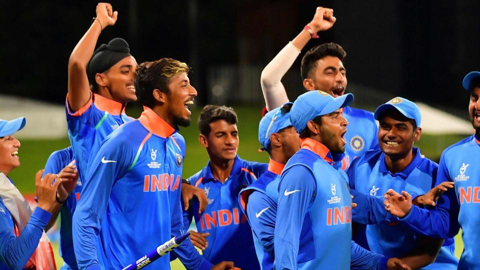 Indian U-19 cricket team players celebrate after beating Australia in the final of the ICC Under-19 Cricket World Cup at Bay Oval in Mount Maunganui on Saturday. Rahul Dravid's men beat Australia by eight wickets to lift their fourth title.