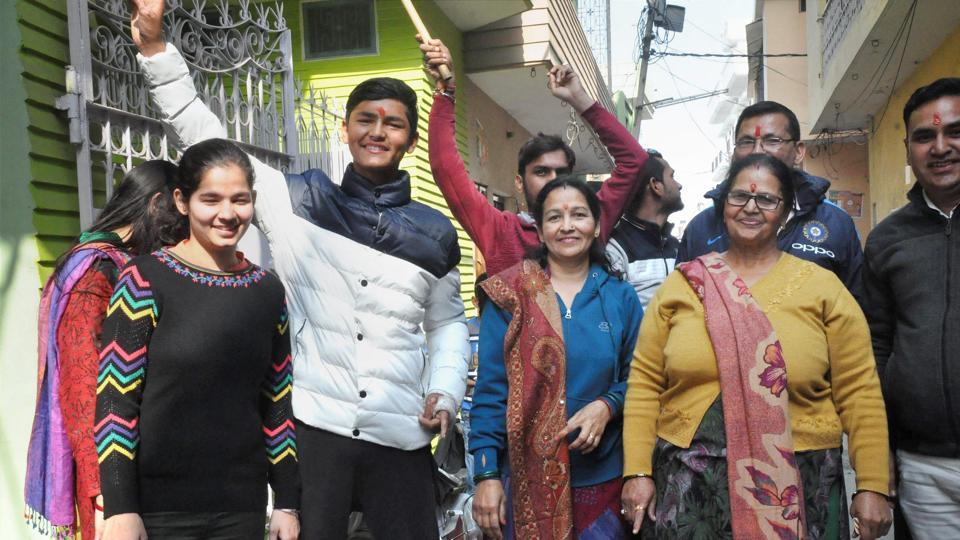 Relatives of cricketer Shiva Singh celebrate India's win. This was the fourth time India won the U-19 World Cup.  (PTI)