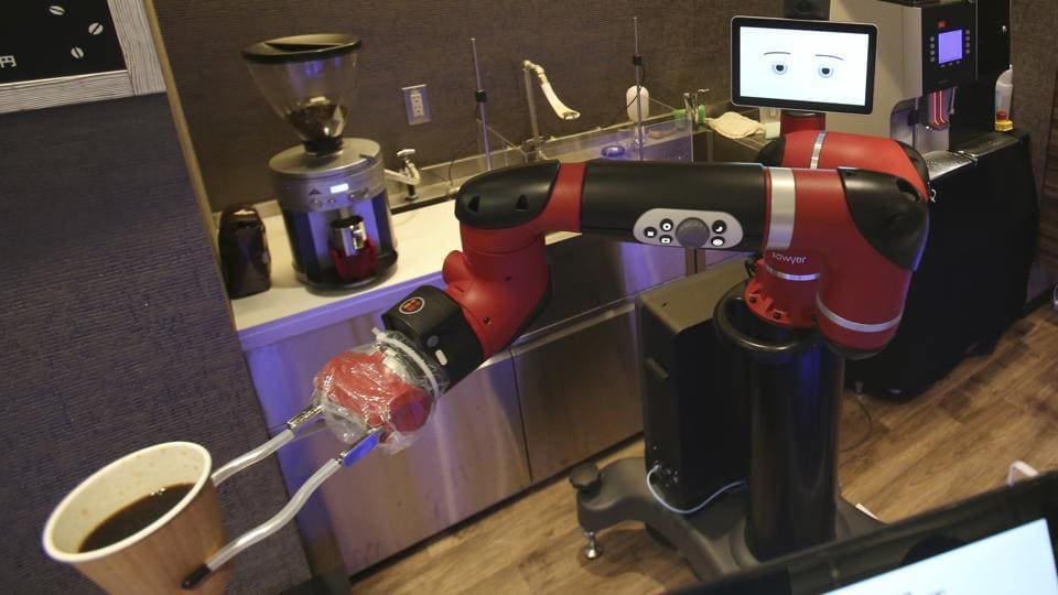 Robot barista Sawyer makes a coffee at Henna Cafe, Japan.