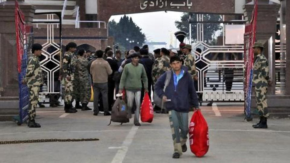Indian fishermen released by Pakistan return home via the India-Pakistan border at Wagah.