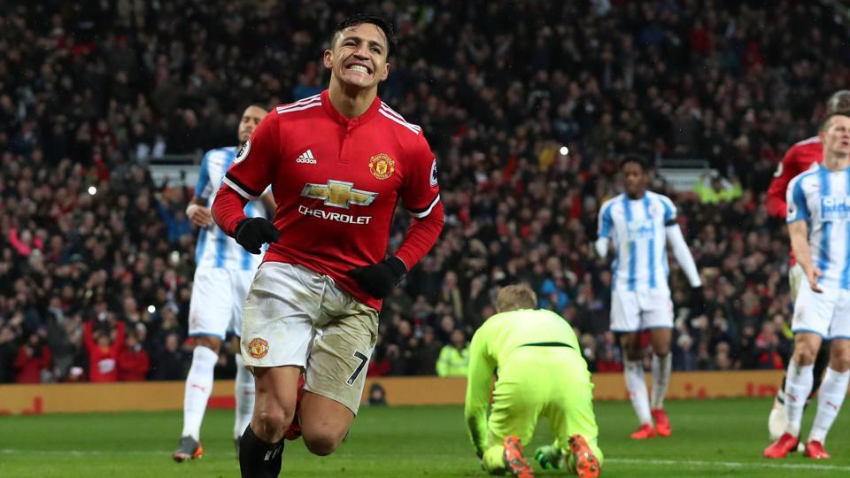 Alexis Sanchez guided Manchester United to a 2-0 win over Huddersfield Town in the Premier League.