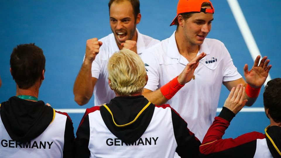 Tim Puetz (top C) and Jan-Lennard Struff (top R) of Germany celebrate with teammates following their doubles match against Matthew Ebden and John Peers of Australia in their Davis Cup World Group tie at Pat Rafter Arena in Brisbane on Saturday.