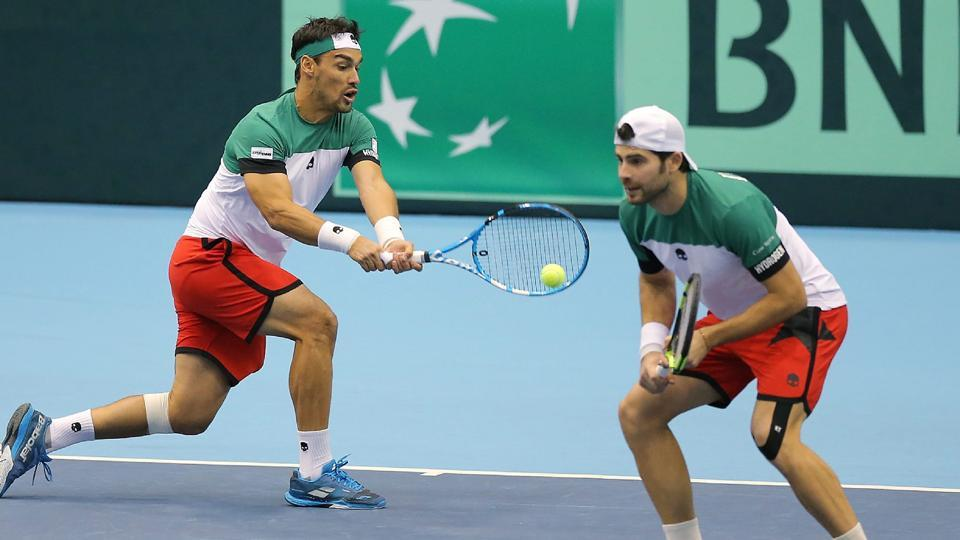 Italy's Fabio Fognini (L) returns a shot as his partner Simone Bolelli makes way in their Davis Cup World Group doubles match against Japan's Yasutaka Uchiyama and Ben McLachlan in Morioka, Iwate prefecture, Japan, on Saturday.