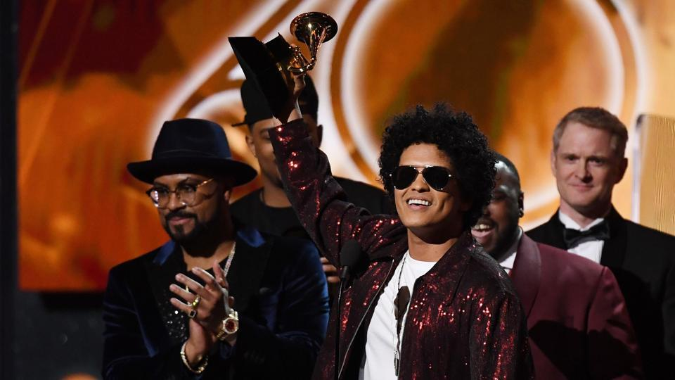 """The feel-good Bruno Mars, who has revived retro funk and R&B for a new generation, swept the 60th Grammy Awards in a surprise snub for the hip-hop world. Mars took home Album of the Year for """"24K Magic"""" as well as Record of the Year, which recognizes the top tune, for the album's title track. (Timothy A. Clary / AFP)"""