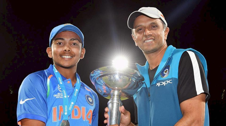 Indian U-19 cricket team captain Prithvi Shaw and coach Rahul Dravid with the trophy after winning the ICC Under-19 Cricket World Cup final in Mount Maunganui on Saturday.