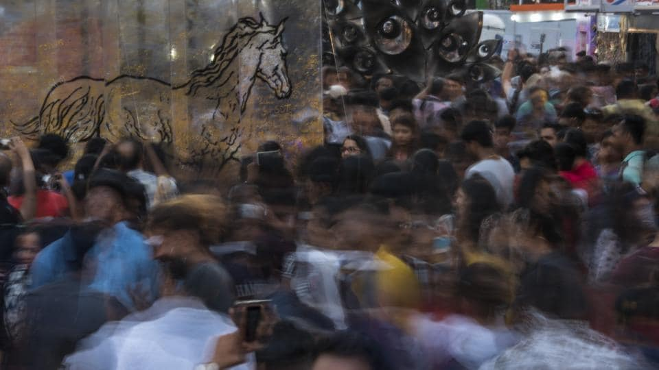 Visitors enjoy the installations at Kala Ghoda on Friday.
