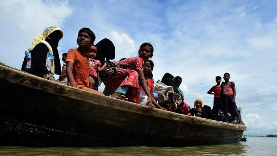 Rohingya Muslim refugees disembark from a boat on the Bangladeshi side of Naf river in Teknaf on September 12, 2017.