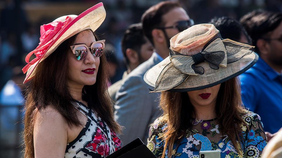 8681858af6e Spectators don hats decorated with bright-textured ribbons and bows.  (Pratik Chorge