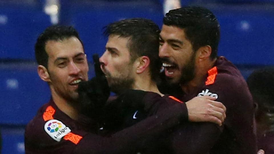 Gerard Pique's (center) late strike guided FC Barcelona to a 1-1 draw against Espanyol in La Liga.