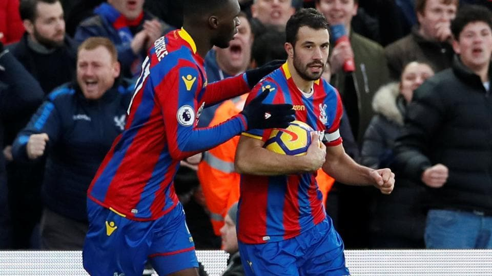 Crystal Palace's Luka Milivojevic celebrates with Christian Benteke after scoring against Newcastle United in their Premier League match on Sunday.