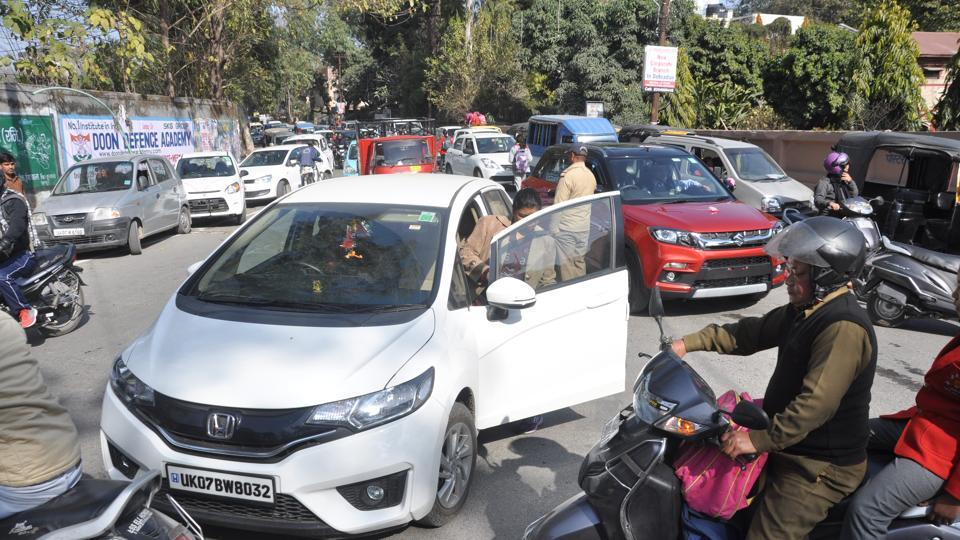 Cars parked haphazardly outside Convent School in Dehradun.