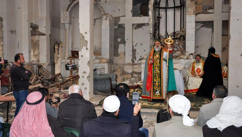 Syriac Orthodox Patriarch of Antioch, Ignatius Aphrem II, gives a sermon during mass at the heavily damaged Syriac Orthodox church of St. Mary in Syria's eastern city of Deir Ezzor on February 3, 2018.