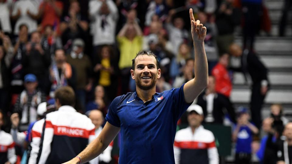 France's Adrian Mannarino celebrates after winning his singles tennis match against Robin Haase of The Netherlands in their Davis Cup World Group first round tie in Albertville on Sunday.